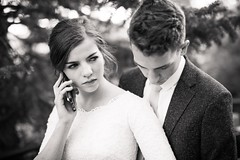 Behind the scenes (aamith) Tags: weddingdress couple blackandwhite groom candid phone bride wedding