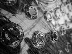 Oh... (TejaO) Tags: reflection bw blackandwhite circles random abstract woodgrain