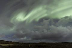A fight between aurora and clouds (Kjartan Guðmundur) Tags: iceland ísland auroraborealis northernlights nightscape nocturne ngc nordlys nature clouds stars sky outdoor sigma14mmf18art canoneos5dmarkiv kjartanguðmundur