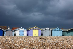Ominous clouds over the downs... (oh.suzannah) Tags: beachhuts rainclouds