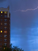 Discharge (Brennan Wille) Tags: lightning thunderstorm thunderhead storm bolt rain rainstorm curtain rainshaft cumulonimbus stormchasers electric spring may 2018 canon canonpowershotg12 brennanwille architecture sky blue clouds severe evening nature discharge stlouis missouri midwest longexposure tripod highrise