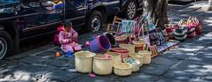 2018 - Mexico City - Weaving Sales (Ted's photos - Returns 23 Jun) Tags: 2018 cdmx coyoacan cropped mexico mexicocity nikon nikond750 nikonfx tedmcgrath tedsphotos tedsphotosmexico vignetting wideangle widescreen baskets streetscene street vehicle shadow shadows kid child girl