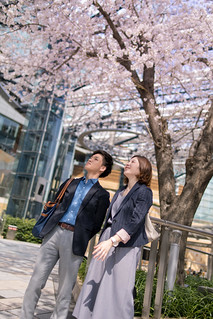 Young business people waiting for clients under cherry tree