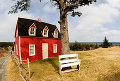 Red Cottage (Karen_Chappell) Tags: red green blue tree house cabin cottage building fisheye wideangle canonef815mmf4lfisheyeusm newfoundland nfld torscove cribbies avalonpeninsula atlanticcanada canada architecture rural bench white fence garden scenery scenic landscape eastcoast