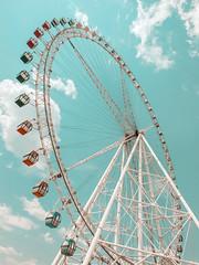ferris wheel (葫呱Huqua) Tags: ferriswheel round fun interesting park havefun sky blue bluesky clouds outdoor wheel colors retro vintage life weekend holiday bright clean scenery view verticle travel