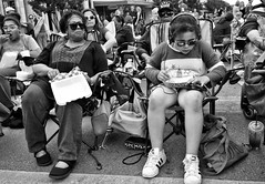 Golden Chick (Anne Worner) Tags: redpoppy2018 anneworner georgetown georgetownpoppyfestival2018 goldenchic ricohgr texas bw bag blackandwhite candid chairs crowd downtown drink eating food girl headphones icedteah iphone jeans mono people purse shorts sitting sneakers street streetphotography top woman