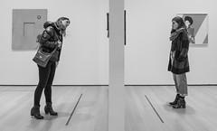 Walls (John St John Photography) Tags: moma museumofmodernart 53rdstreet streetphotography candidphotography newphotography exhibition photographs women looking studying appreciating enjoying wall peopleofnewyork bw blackandwhite blackwhite blackwhitephotos johnstjohn