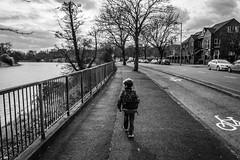 On The Way (Bokehlicious Harold) Tags: boy street walking bag black white nikon