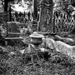 An Old Cemetery In Pensacola Florida (Modkuse) Tags: cemetery florida pensacolafl nikon nikonf nikonslr 50mmf14 tombstone tombstones monochrome monochromefromkodachrome monochromefromslide bw blackandwhite