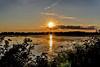 Sunset over Lake Butte des Morts (Brian Kermath (e.h.designs)) Tags: sunset over lake butte des morts sun sunflare solarflare flare lakebuttedesmorts oshkoshwisconsin oshkosh wisconsin sky reflection reflections clouds