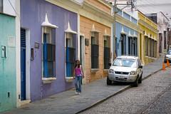 Ciudad Bolívar (Stig Nygaard) Tags: 2010 a650 a650is bolivarianrepublicofvenezuela bolívar bolívarstate canonpowershota650is ciudadbolivar ciudadbolívar creativecommons estadobolívar guayana guayanaregion lapeña photobystignygaard repúblicabolivarianadevenezuela venezuela colorful catchycolors colourful colours colors magenta orange yellow blue lilla coloredhouse colored coloredhouses colorfulstreet street town city girl pretty prettiness cuw18 ven southamerica
