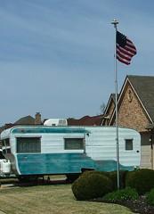 Suburban Camping (jHc__johart) Tags: trailer camper home flag flagpole yard house shrub oklahoma