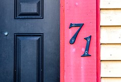 71 (Karen_Chappell) Tags: 71 number house building home door pink paint painted wood wooden jellybeanrow siding clapboard stjohns downtown city urban rowhouse black yellow colourful colours multicoloured canada atlanticcanada newfoundland nfld avalonpeninsula architecture