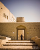 The Black Magic of Al Qabasah (Bahla, Sultanate of Oman, 2017) (Alex Stoen) Tags: alqabasah alexstoenphotography architecture bahlafort blackmagic desert door escape exit fort frame geotagged history leicamptyp240 medieval mudbrick ngexpeditions oman orient shadows shelter sultanateofoman summiluxm35mm superstition travel unescoworldheritagesite vacation contrast creative interesting storytelling bahla