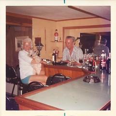 Basement Bar, 1973 (STUDIOZ7) Tags: 1970s 70s seventies man woman dog coke cocacola booze alcohol drinking bar home basement toysoldier bottles seagram