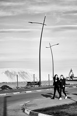 Apr 06, 2018 (pavelkhurlapov) Tags: geometry lampposts weird girls road walkway sky contrast monochrome light shadows icecream milkshake gravel tractor streetphotography