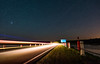 Speed of Light (free3yourmind) Tags: speed light fast furious car passing night sky stars starry belarus vileika bridge lake sign