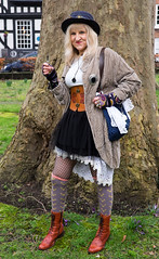 Time for an e-cigarette (f22photographie) Tags: shrewsburysteampunkfestival2018 imagination costume fashion fun fantasy fancydress glamour boots tights fishnetstockings leather handbag jewellery hats goggles women steampunkcommunity shortskirt lace leatherboots