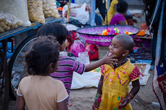 Tasting... (Ivon Murugesan) Tags: culture festival festivity hindufestival indianfestival maasimagam mahabalipuram mamallapuram masimagam street streetphotography tamilfestival tamilnadu tradition bright kids childrens event digital orange portrait art light yellow people family house new travel places letsexplore ivonmurugesan india seashoretemple sevenpagodas