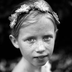 Spring girl (B&W) (PascallacsaP) Tags: young girl flowers hair spring springtime sweet zhongyimitakonspeedmaster35mmf095markii mitakon f095 portrait portraiture freckles blackandwhite bw monochrome fujineopan1600 filmsimulation dreamy bokeh
