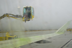 De-ice the Plane (aaronrhawkins) Tags: deice plane airplaine wing anitfreeze saltlakecity spray freeze rain snow cold spring weather green splash stream airport takeoff aaronhawkins
