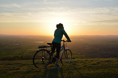 Cycling towards the sunset (in explore) (Gwenael B) Tags: cycling sunset cheltenham uk cotswolds cleevecommon cleeve hill landscape people cyclist girl bicycle view nikond5200 nikon shadow silhouette colorful coucherdesoleil colline vue velo bike