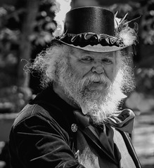 Aye, Do I Look Like I Have a Pot of Gold (clarkcg photography) Tags: man male hat beard white jacket leprechaun twinkle eye faire renaissance blackandwhite blackwhite bw blackandwhitethursday thursdayblackandwhite 7dwf gold potofgold treasure
