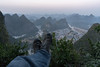 Yangshuo Tower - Boot Shot (virtualwayfarer) Tags: guilinshi guangxizhuangzuzizhiqu china cn chinese visitchina chinesetourism guilinregion yangshuo yangshuotower sunset dusk light lightrays landscape countryside mountains nature naturephotography landscapephotography travel tourism explore exploring adventuretravel topoftheworld overview karst karstformation karstmountain yangshuotown amazinglight sunlight mist sony sonyalpha a7rii alexberger virtualwayfarer travelphotography brothersberger travelingboots boots bootshot spiritoftravel spiritofadventure scarpa scarpashoes guanxi