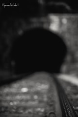Rest Your Weary Head And Let The Darkness Take You (SpencerTheCookePhotography) Tags: tunnel dark darkness creepy emotion dof depthoffield railroad blackandwhite canon