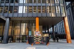 Work In Progress (cookedphotos) Tags: 2018inpictures toronto ontario canada canon 5dmarkiv streetphotography architecture financialdistrict downtown skyscraper column pillar construction work worker black orange progress 365project p3652018