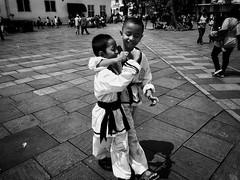 Their fingers said it all 😂 (-Faisal Aljunied - !!) Tags: vulgar fingersign kids streetphotography martialarts indonesia jakarta faisalaljunied