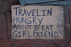 Bon Appetit! (Omunene) Tags: homeless creative shadowedfont spelledfriendcorrectly cardboardsign shouldhaveusedanapostropheaftertravelin travelingbyroadandrail