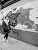 Northern Quarter 211 (Peter.Bartlett) Tags: manchester bag noiretblanc art unitedkingdom people city graffiti cigarette woman peterbartlett walking girl urban candid uk m43 microfourthirds streetphotography bw smoking sign blackandwhite niksilverefex olympuspenf england gb