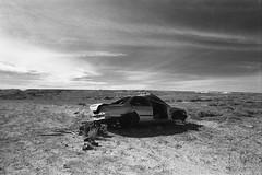 1325 (The Dent.) Tags: kodakhawkeyesurveillancefilm south australia coober pedy tmx dev 19 10 mins 2485 analogphotography nikon f100 24mm red filter desert outback wreckage