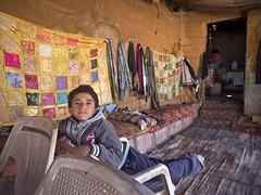 Bedouin Boy (newzild) Tags: jordan middle east petra bedouin boy jordanian tent plastic chairs sand olympus pen ep3 m zuiko 12mm f20 24mm wide ultrawide angle micro four thirds m43
