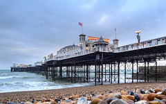 Palace pier (Arild Vågen) Tags: palacepier england eastsussex uk pier water coast beach construction longexposure sunset evening ocean sea seaside buildings vivid column architecture outdoor stones