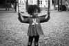 In the park (Beth Reynolds) Tags: kids park playground swing child neighborhood portrait candid blackandwhite minnie