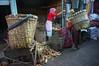 carrying coconut (kuuan) Tags: indonesia voigtländerheliarf4515mm manualfocus mf voigtländer15mm aspherical f4515mm superwideheliar apsc sonynex5n solo surakarta street java market bazaar pasar pasarlegi coconut worker carrying heavyload woman women
