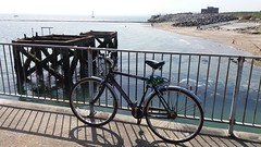 Eastney pier & bike (mr broddy) Tags: bicycle pier eastney tide sea beach railing yacht sail defences rock structure fort portsmouth southsea hampshire wheel cumberland haze langstone outfall fence