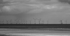 Wind Powered. (f_gray1) Tags: wind turbines monochrome photo photograph photography black white sea seascape sand beach skegness sky