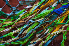 Harlem Ribbons 2 (justingreen19) Tags: 125thstreet community fabric harlem ny nyc newyork newyorkcity angle blue creative decorative entwine entwined fence fencing green interweave justingreen19 manhattan newyorkphoto newyorkphotography nycphotography pattern ribbon ribbons ribbonsonfence texture tiedtogether turquoise twist twisted urban urbanabstract urbanart urbanphotography yellow