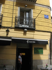Café Figueroa, Historic Gay Bar, Chueca (d.kevan) Tags: madrid spain chueca figueroa bars gaybars balconies signs decorativedetails terraces chairs tables flowers people doorways lamps caféfigueroa cafés calleaugustofigueroa historicbar