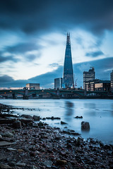 Glass and shards (The Frustrated Photog (Anthony) ADPphotography) Tags: category citiestowns england london longexposure places riverthames theshard travel water river sky buildings building officeblock skyline cityscape motionblur uk unitedkingdom britain greatbritain shore beach pebbles timber canon canon70d canon1585mm travelphotography outdoor