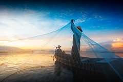 Silhouette of fishermen using nets to catch fish at the lake in the morning (Patrick Foto ;)) Tags: 8 asia asian balance blue boat burma cambodia entrapment environment farmer fish fisherman fishing food job kayak lake laos lifestyle man mirror myanmar nature net paddle peaceful poor poverty province reflect reflection ripple river sky sunlight sunrise sunset thailand tourism tradition traditional tranquil travel tropical vietnam water weed tambonbangphra changwatchonburi th