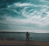 En Cyklist Bort (J Holmes-Leather) Tags: neon bicycle sea blue people outdoors sweden life water sky clouds