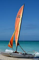 Hobie Cat (Poocher7) Tags: beach sand waves water ocean gulfofmexico varadero cuba carribean sailboat hobiecat orange floats orangefloats sails orangeandyellowsails yellow bluesky sundaylights