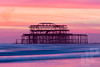 The Old Brighton Pier (LongLensPhotography.co.uk - Daugirdas Tomas Racys) Tags: brighton brightonpier britain england uk afterglow burnt coast coastline dusk evening fire ghost glow landscape magenta pier pink pinksky purplesky remains scaffold sea shore southcoast sunset waves