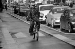 Uber on the Way (06mod) (AngusInShetland) Tags: italy uber bicycle cyclist delivery traffic milan milano minoltadynax7000i berggerpancro400 35mm film road urban