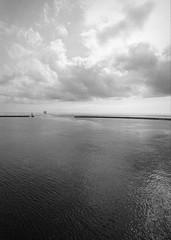 Leaving II (p2-r2) Tags: nikon f3 f3hp blackandwhite film kodak sea ship ferry water sky clouds trix 400 seawall