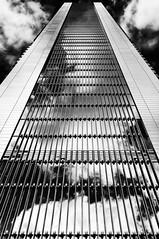 Infinity (Leipzig_trifft_Wien) Tags: madrid comunidaddemadrid spanien es contemporary modern architecture lines glass reflection building skyscraper tower torre black white monochrome city urban contrast high pov perspective vanishing clouds sky mirror
